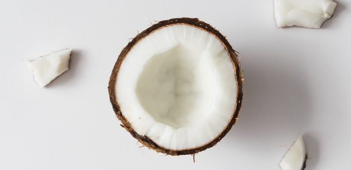 Half coconut on white table