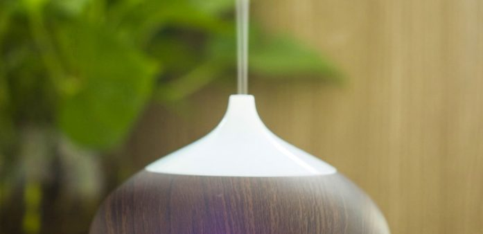 Wooden style vase aroma diffuser on wooden table